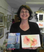 Jana with her paintings